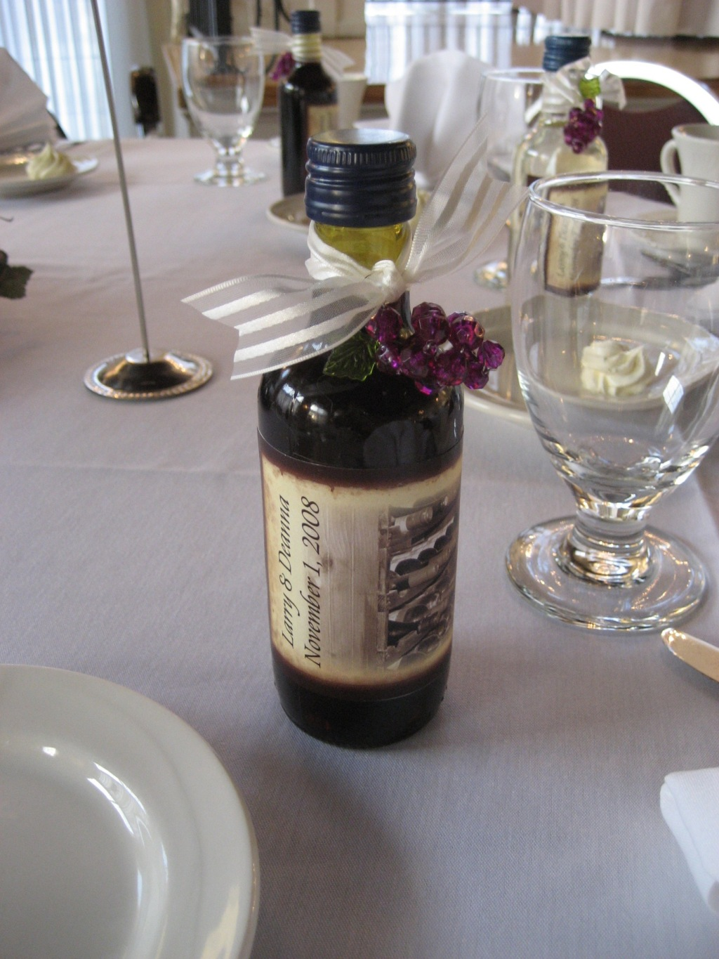 mini wine bottles with custom lables were a hit as favors a wedding