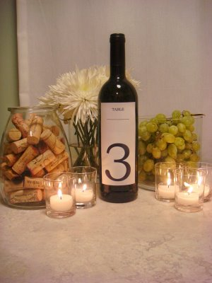 Or how about wine bottle table numbers Stop in at Wedding Centerpiece Ideas